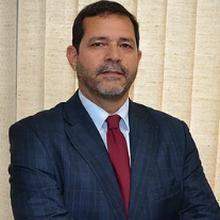 Dr. Edson Alvisi Neves